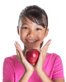 Young Asian Malay Teenager With A Red Apple VI Royalty Free Stock Photo