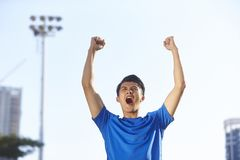 Young asian athlete celebrating victory royalty free stock photos