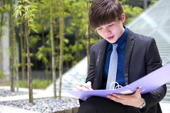 Young Asian male business executive holding file Royalty Free Stock Photo