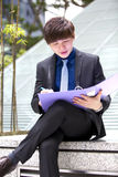 Young Asian male business executive holding file Stock Photo