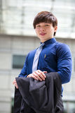 Young Asian male business executive smiling portrait Royalty Free Stock Images