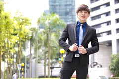 Young Asian male business executive smiling portrait Stock Photo