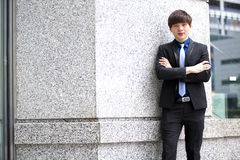 Young Asian male business executive smiling portrait Royalty Free Stock Image
