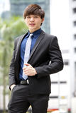 Young Asian male business executive smiling portrait Stock Photos