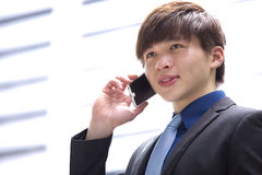 Young Asian male business executive using smart phone Stock Photos