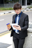 Young Asian male business executive using tablet PC Stock Images