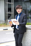Young Asian male business executive using tablet PC Stock Photos