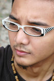 Young Asian Male Close Up. Close up of handsome Asian male looking sad Royalty Free Stock Images