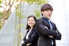 Young Asian male and female business executive smiling portrait. Outdoor Royalty Free Stock Photo