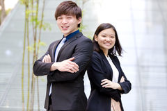 Young Asian male and female business executive smiling portrait Stock Images