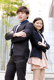 Young Asian male and female business executive smiling portrait Stock Image