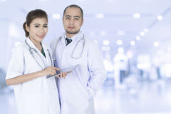 Young Asian male and female doctors Royalty Free Stock Photos
