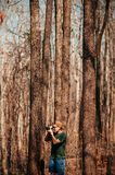 Young asian male photographer with casual cloth in forest travel royalty free stock image