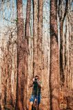 Young asian male photographer with casual cloth in forest travel royalty free stock images