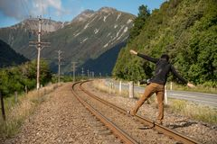Young Asian male photographer walking on railway Stock Images