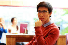 Young asian male student. Sitting in classroom Royalty Free Stock Photo