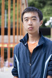 Young asian man. Smiles in the background of orange brige Royalty Free Stock Photography