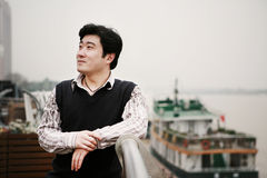 Young asian man beside aboard. A young asian man beside aboard Royalty Free Stock Photos