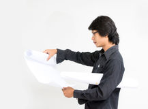 Young asian man architect looking to plan Stock Images