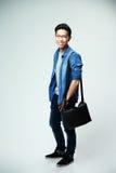 Young asian man with bag Stock Photos