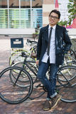 Young asian man with bicycle Royalty Free Stock Photo