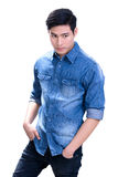 Young Asian man in blue jean shirt Stock Images