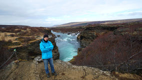 Young Asian man with blur outdoor jacket in Iceland visit Hraunf Stock Photos