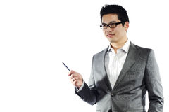 Young asian man in business attire holding pen. Teaching something Stock Photography
