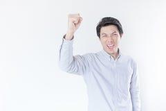 Young Asian man celebrating his success Stock Photos
