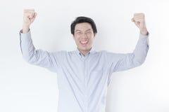 Young Asian man celebrating his success Stock Photography