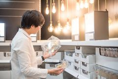 Young Asian man shopping electrical light bulb stock photography