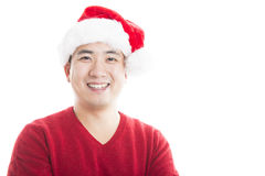 Young asian man with Christmas hat isolated on white. Stock Photo