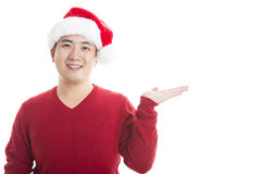 Young asian man with Christmas hat isolated on white. Royalty Free Stock Photo