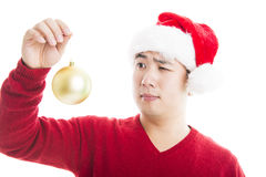 Young asian man with Christmas hat isolated on white. Stock Photos