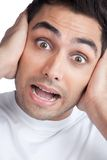 Young Asian Man Covering Ears Stock Photography