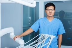 Young asian man dentist with dentist tools at the clinic. Dentis. Try, medicine, medical equipment and stomatology concept Royalty Free Stock Photos