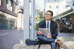 Young asian man with digital tablet Royalty Free Stock Photography