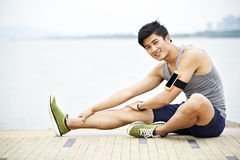 Young asian man exercising outdoors stock photos