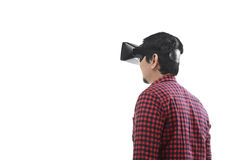 Young asian man experiencing virtual reality through a VR headse Royalty Free Stock Photography