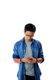 Young asian man in glasses using smartphone Royalty Free Stock Images