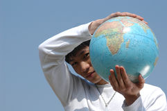 Young Asian Man with a Globe Stock Photo