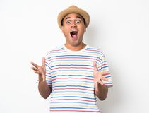 Young Asian man with hat feels shock and surprise with overly face expression. Asian man with hat feels shock and surprise with overly face expression royalty free stock images