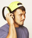 Young asian man in hat and headphones listening Royalty Free Stock Photography