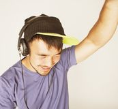 Young asian man in hat and headphones listening Stock Photo