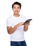 Young Asian man having a smart pad PC Royalty Free Stock Images