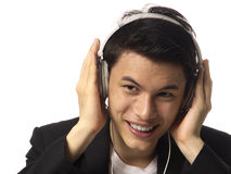 Young Asian Man with Headphones Stock Images