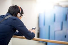 Young Asian man using smartphone for online shopping Royalty Free Stock Images