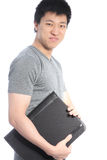 Young Asian Man Holding a Black Binder Stock Photo