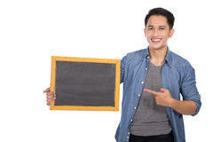 Young asian man holding blackboard on white background Stock Photography