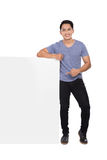 Young asian man holding a blank banner Stock Image